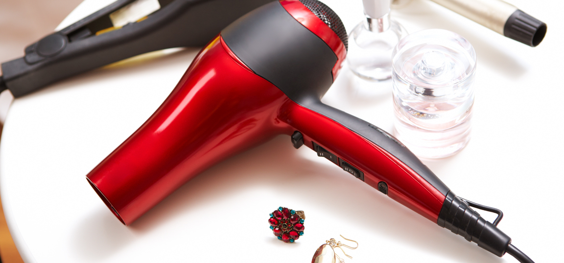 Red hairdryer on table