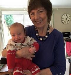 Grandmother holding grandchild