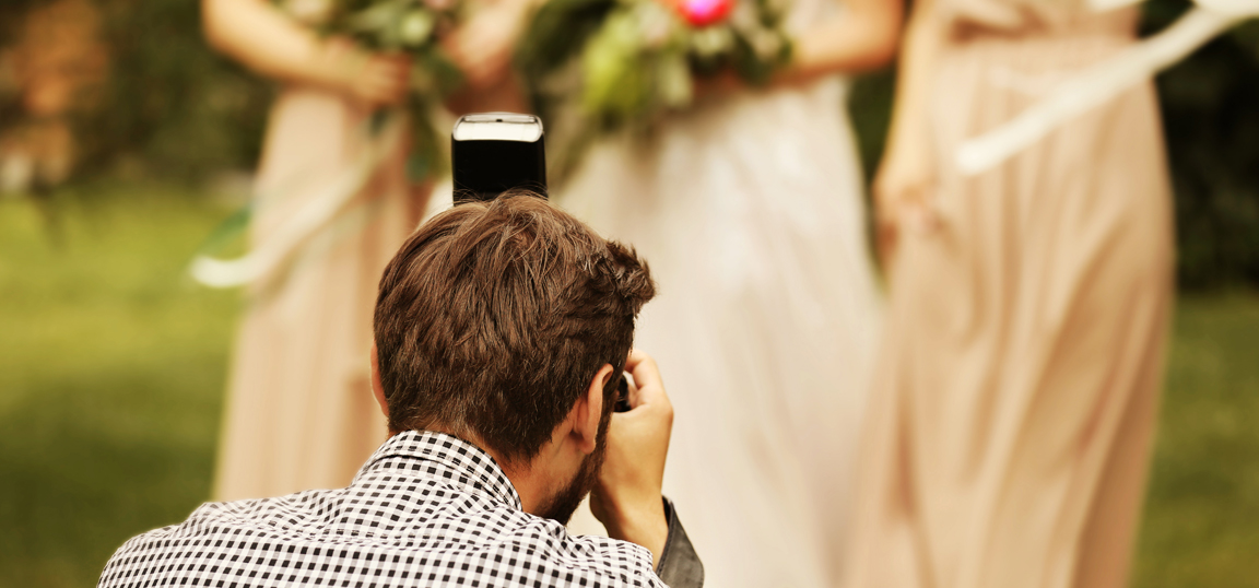 Photographer taking photo of bridesmaids