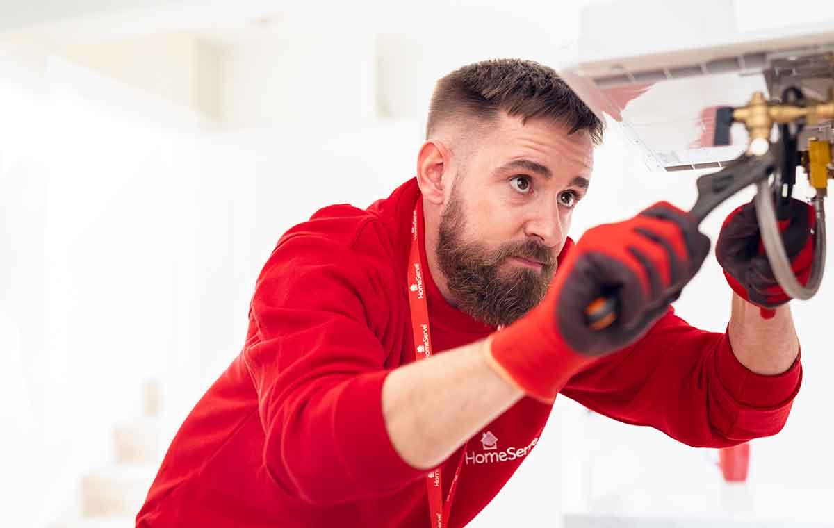 HomeServe engineer fixing a boiler