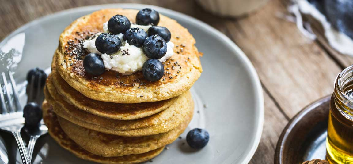Blueberries on pancakes with seeds