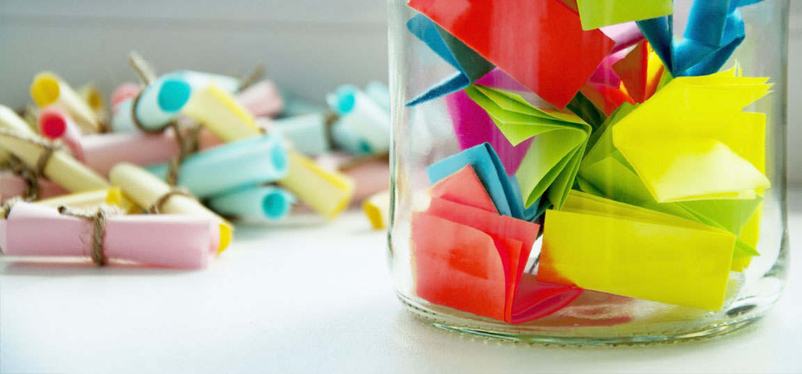 Coloured notes in a jar