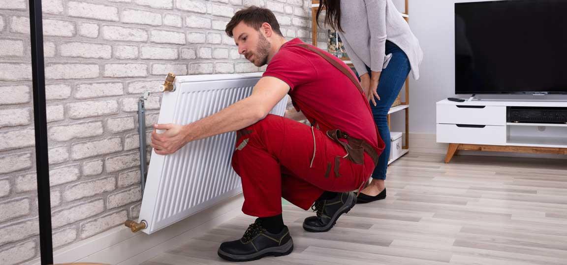 Man removing radiator