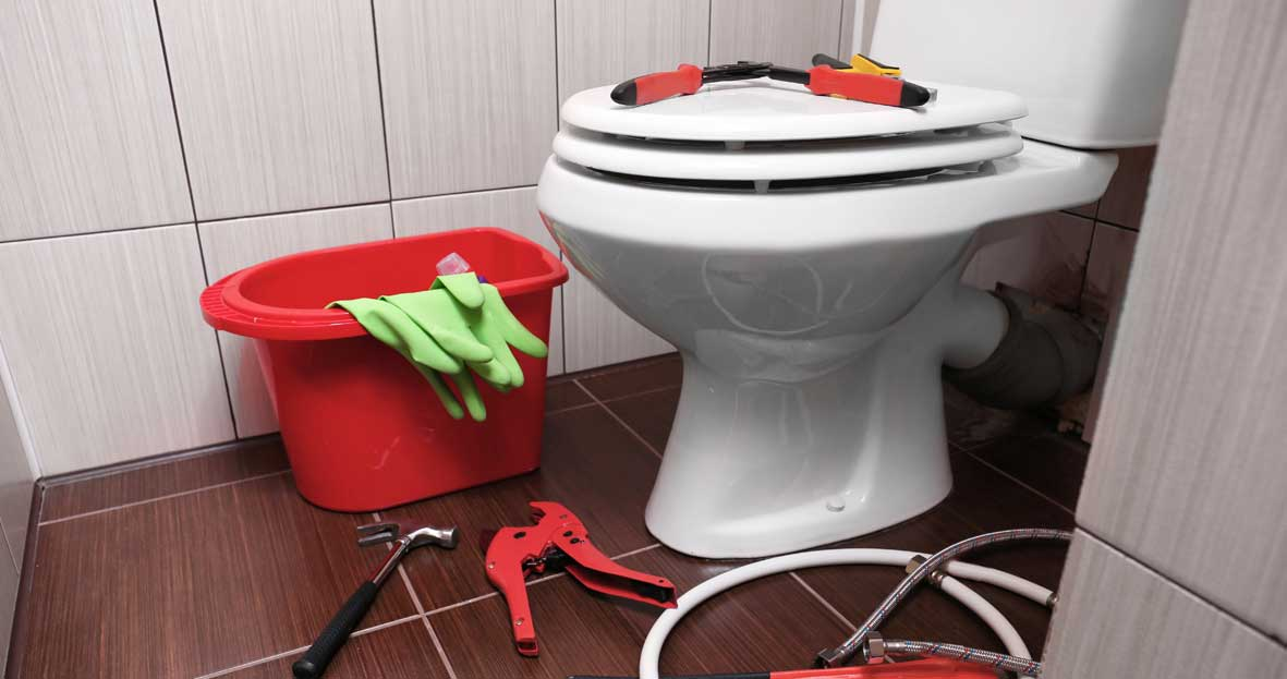 A toilet with tools to fix it
