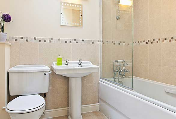 Biege bathroom with white bathroom suite