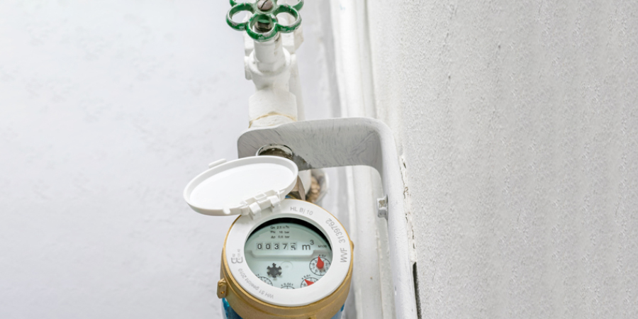 A modern water meter and stop-cock, with a key to turn it off